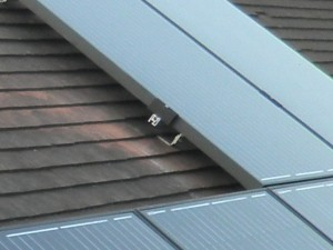 On-roof: plain tiles, showing rails and panels fitted