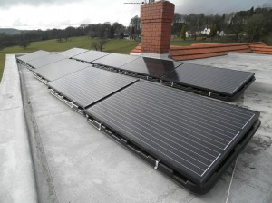 10 x Suntellite solar panels on flat roof