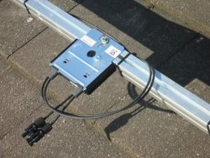 Solaredge power optimiser mounted behind solar panel
