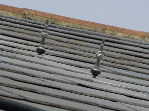 Hanger bolts drilled into a slate roof (Image found on Google - it's not ours!)