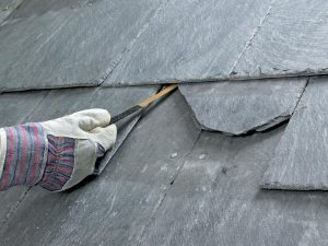 Using a slate ripper to remove a broken slate